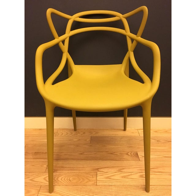 This is an authentic set of 4 mustard yellow Kartell Masters chairs. Designed by the iconoclastic Phillippe Starck, the...