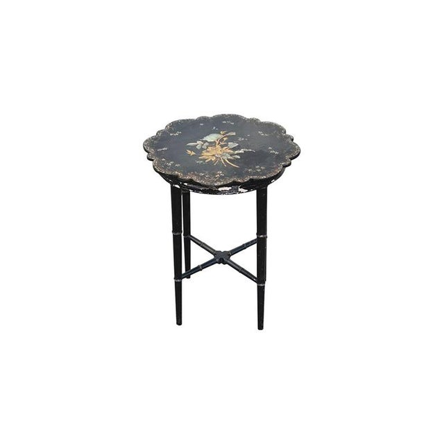 Lightweight chinoiserie side table or small stool. Painted bamboo support system, syncopating scalloped edge on surface....