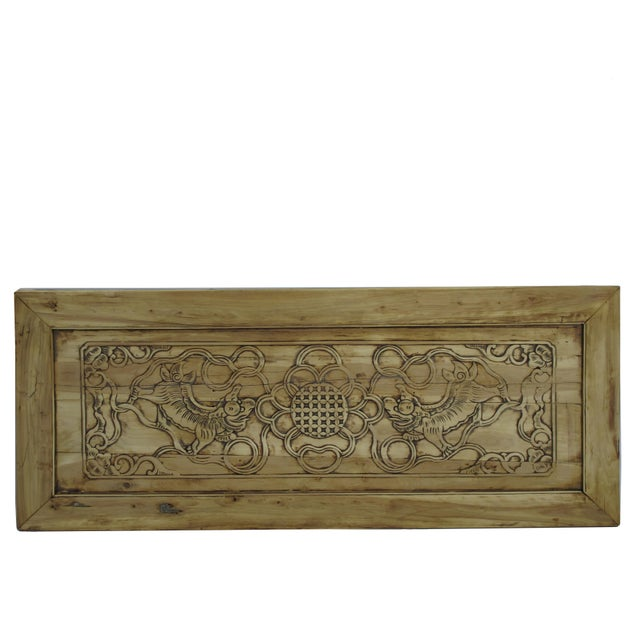 This antique panel is in its original warm original wood color with hand carved two dancing lions and decorative flowers....