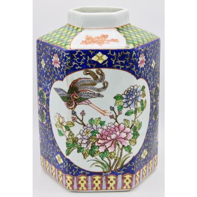 A large antique Chinese ceramic vase with a lovely hand painted exterior. With bright colors and a beautiful geometric...