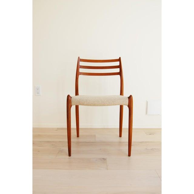 Danish modern teak dining chairs Model 78 designed by Niels Otto Moller for J. L. Moller made in Denmark. The skillfully...