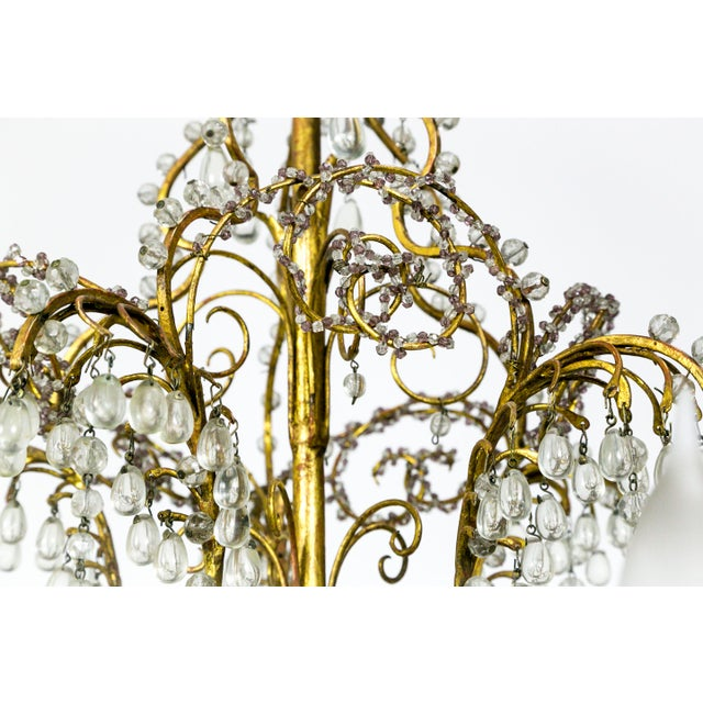 This ornate, crystal beaded, 10-light chandelier has gorgeous, bead encrusted, brass curls and scrolls. Small, lavender...