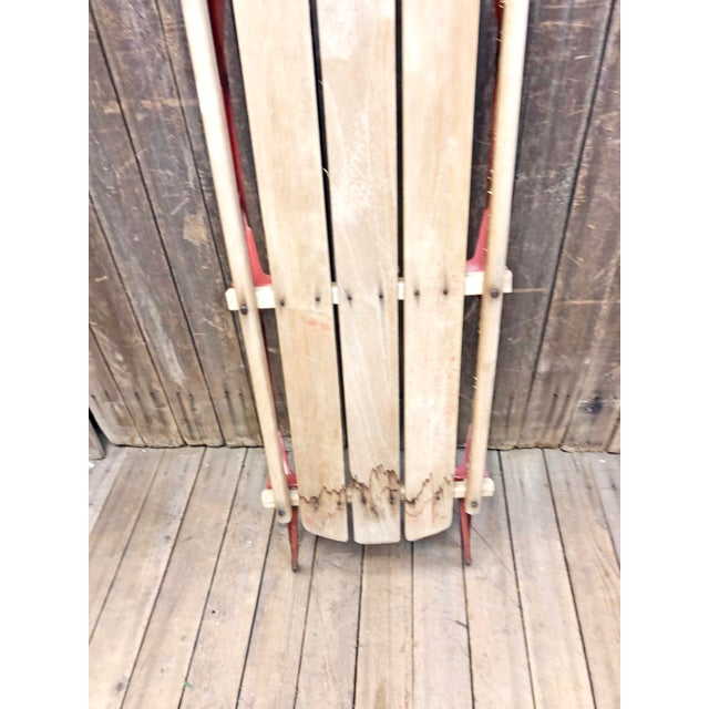 Vintage Wood Sled. Solid wood with metal rails. Piece is in weathered shape as it appears was kept in a barn/garage for...