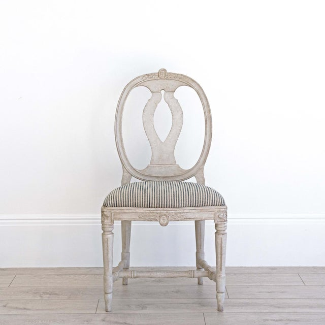 Our beautiful 'Sköld' dining chair is hand crafted in native Swedish birch and is a faithful rendition of an original 18th...