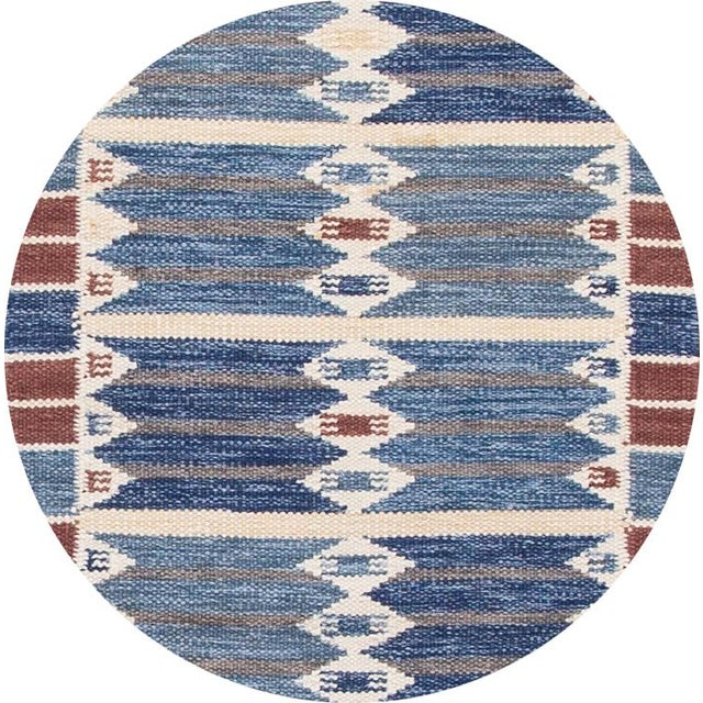 Beautiful contemporary Swedish style runner rug, hand-knotted wool with a blue field, brown and ivory accents in an all-...