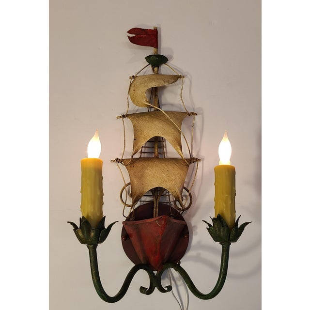 Pair of 1950s Italian tole two-light ship sconces featuring dimensional prows, masts, rigging, and flags with original...