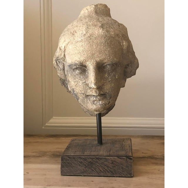This beauty was found during a construction dig in Italy. She is made of limestone and is set on an iron pole with wood...