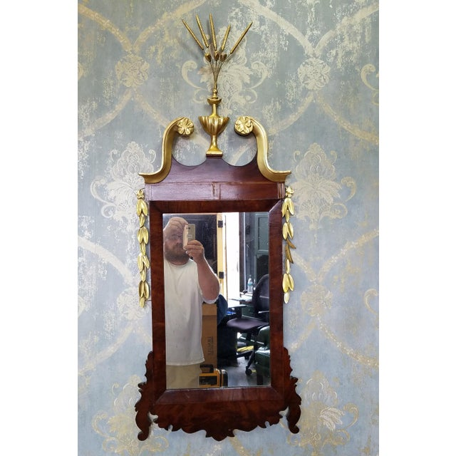 Description: This is a fantastic antique Later American Federal period hanging looking glass mirror, c1810. Mahogany...