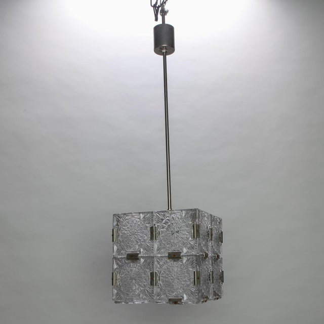 Circa 1970s cube shaped suspended cube light made of clear molded glass panels and nickel metal joiners by Kalmar of...
