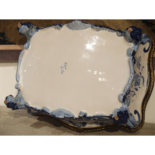 This beautiful antique blue and white Delft table box has scenes of Maritime painting on the top, front and back panels....