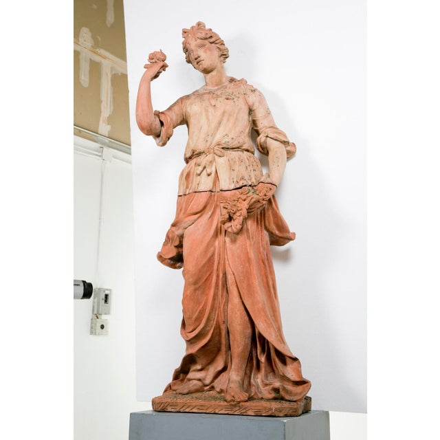 Formed in two parts. A very rare and wonderful statue of the goddess Flora sculpted in terracotta attributed to a student...
