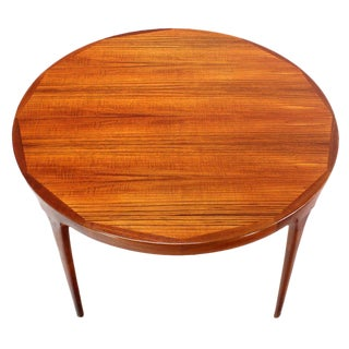 Danish Mid-Century Modern Round Teak Dining Table with Two Leaves For Sale