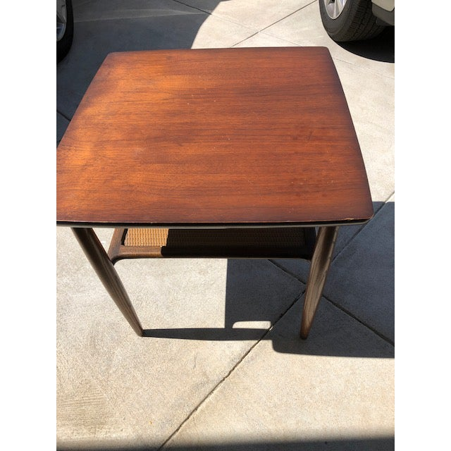 Mid century side table that our family has owned since the 60's they were paired with Danish designer chairs and purchased...