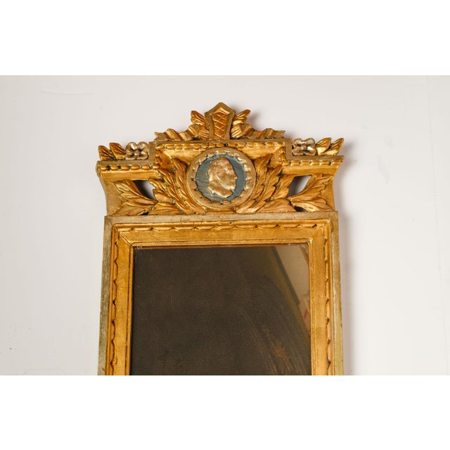 Neoclassical Swedish mirror in hand-carved giltwood and hand-painted decoration. Signed on reverse. Circa 1830-1850.