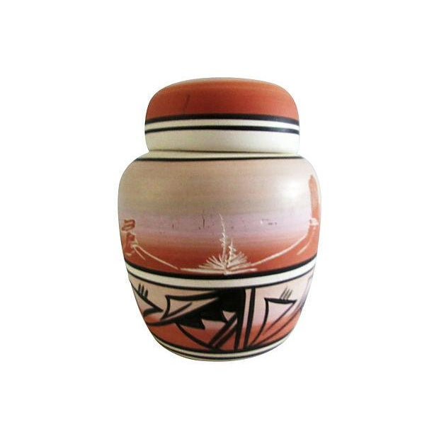 Vintage lidded Navajo pottery jar depicting a desert mountain range with traditional black silhouette design around...