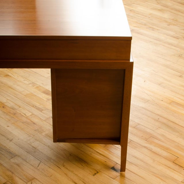 A Mid-Century American walnut desk with side extension designed by John Van Koert for Drexel circa 1960. Materials: Wood,...