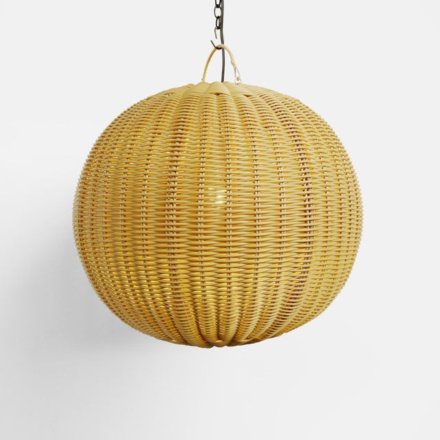 Outdoor faux rattan small globe lantern. Beautifully woven synthetic rattan with a natural wicker appearance. Perfect for...
