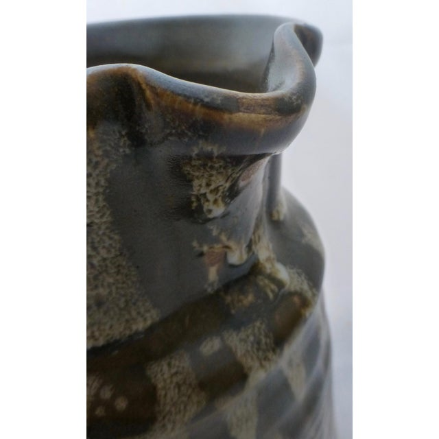 Organic glazed pitcher, this one is in contrasting shades of brown and sand. Large, classic form. This piece has balance...