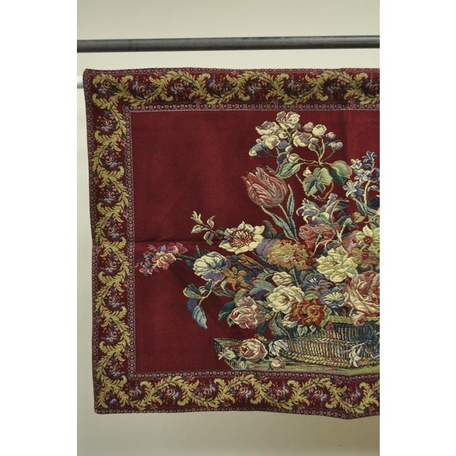 Item: French wall hanging tapestry featuring a floral bouquet still life with a red background and an acanthus border....