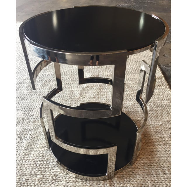 Tinted glass round side table with ornamental chrome base. In perfect condition.