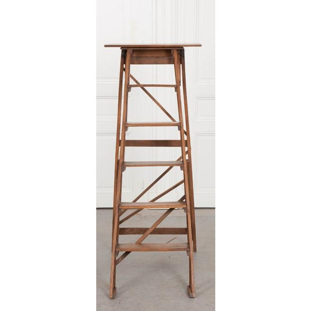An exceptional antique folding ladder from 1900s France. The oak ladder has five steps that are graduated in size. When...