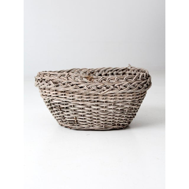 This is an antique wicker basket. The woven basket has a sun-washed tone with braided detail at top. Beautiful accent...