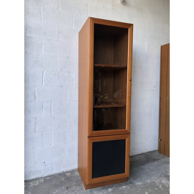 Vintage Mid Century Modern Danish Style Curio Display Cabinet. C 1980s Features a larger top area with a glass door and...
