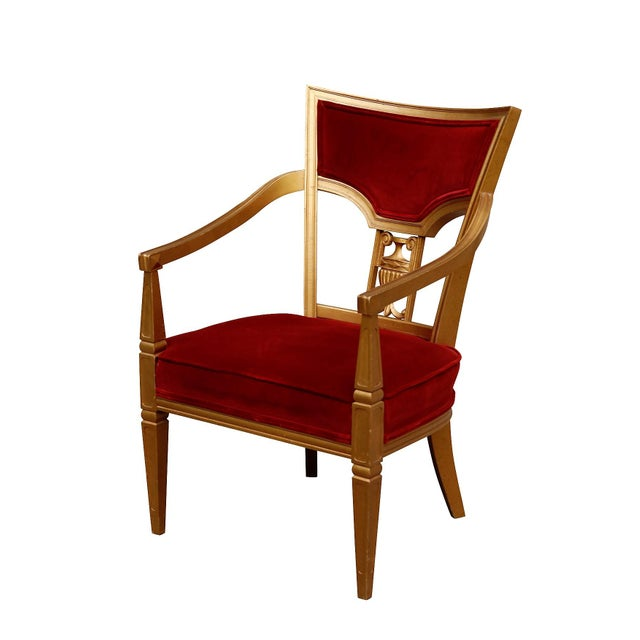 A Royal Throne inspired Louis XVI chair. Cushions are upholstered in deep red velvet with the wooden frame painted rich...