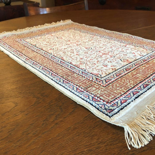 This very small hand knotted carpet has only been used as a wall hanging. We were told the original buyers paid $9000 for...