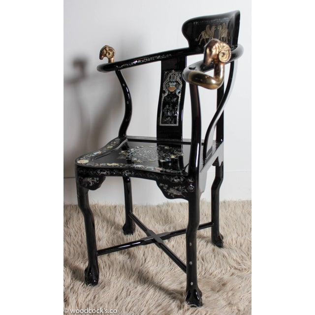 A contemporary French Empire style armchair. The corner chair has a black lacquer finish with extensive mother-of-pearl...