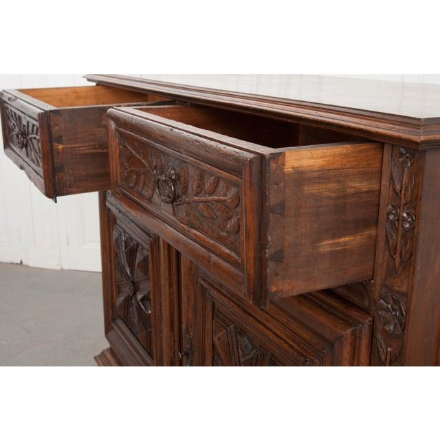 This incredible Louis XIII-Style walnut buffet, c. 1780, is from France and boasts exuberant, beautifully executed hand-...