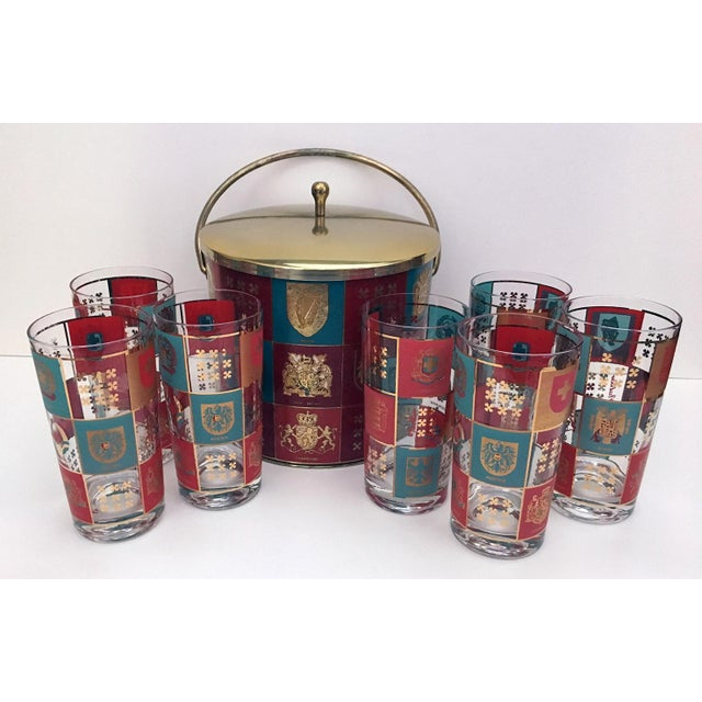 Vintage Fred Press Coat of Arms ice bucket and 7 glass set. Red, gold and turquoise graphic coat of arms from Switzerland,...