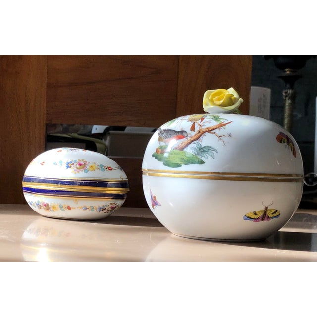 Lovely floral on whit porcelain Trinketier Set, egg with nave band and gilding is Meissen and apple shaped with robin and...