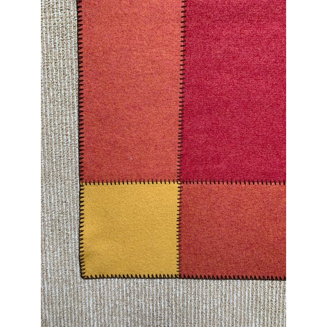 This bright and bold color block felt rug is the perfect accent rug for your space. Composition: 100% woven felt in pure...