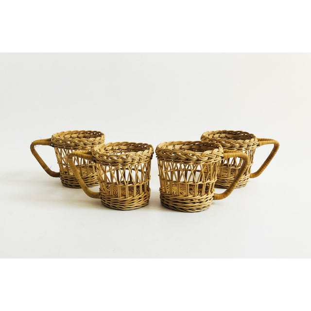 A set of 4 vintage cup or glass cozies. Each with a lovely curly design woven with wicker.