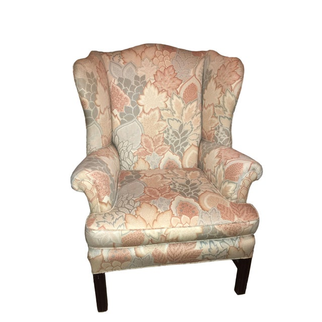 A stylish early to mid-20th Century wingback arm chair, re-upholstered in a pastel floral patterned fabric. Bring elegance...