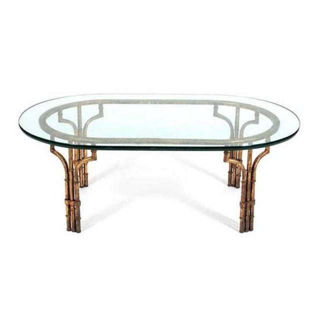 Midcentury Italian gilt metal faux- bamboo glass top coffee table With thick oval glass top on conforming base.