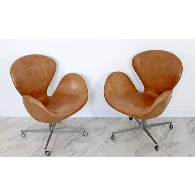 For your consideration is a magnificent pair of swivel, swan chairs on casters, by Arne Jacobsen for Fritz Hansen, circa...