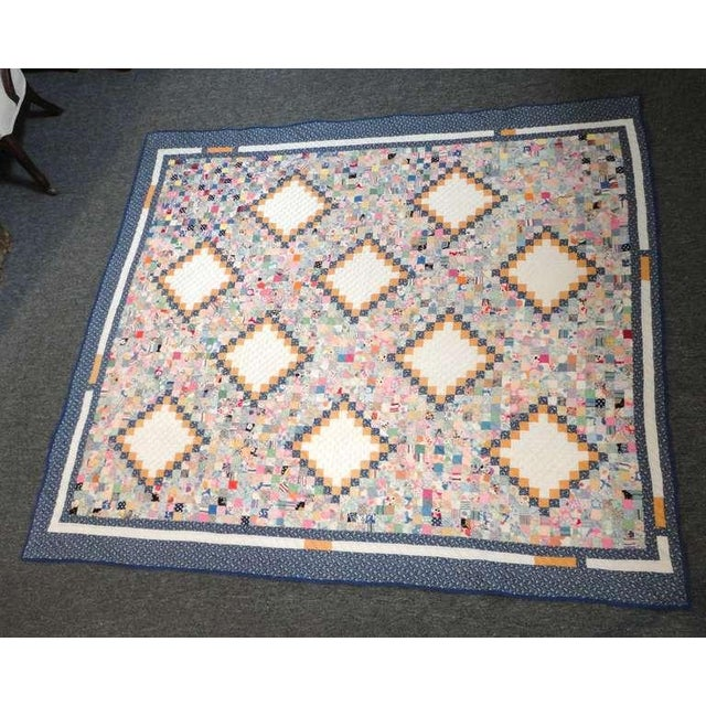 This multi pieced postage stamp quilt in the Philadelphia payment pattern is made up of thousands of pieces in pristine...