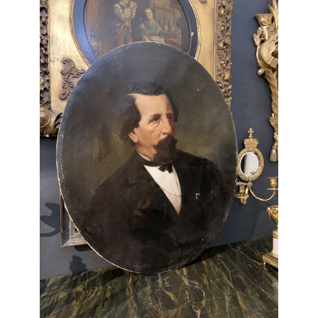 Lovely 19th-century oil on canvas portrait painting of a nobleman. Oval shape, unframed. The canvas has several canvas...