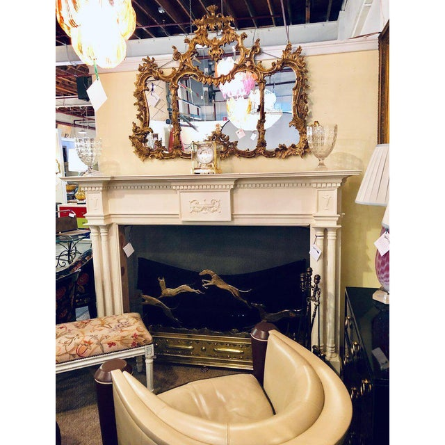 A pair of compatible monumental custom quality solid wood hand carved neoclassical fireplace surrounds. Only one is...