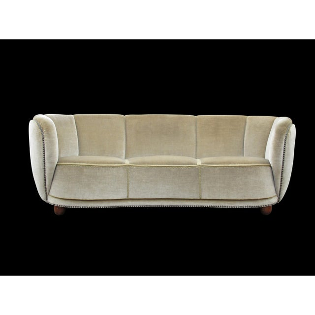 Early 1930's curved back sofa in original mohair fabric with brass tacks along outer edge, eight-way hand tied springs on...
