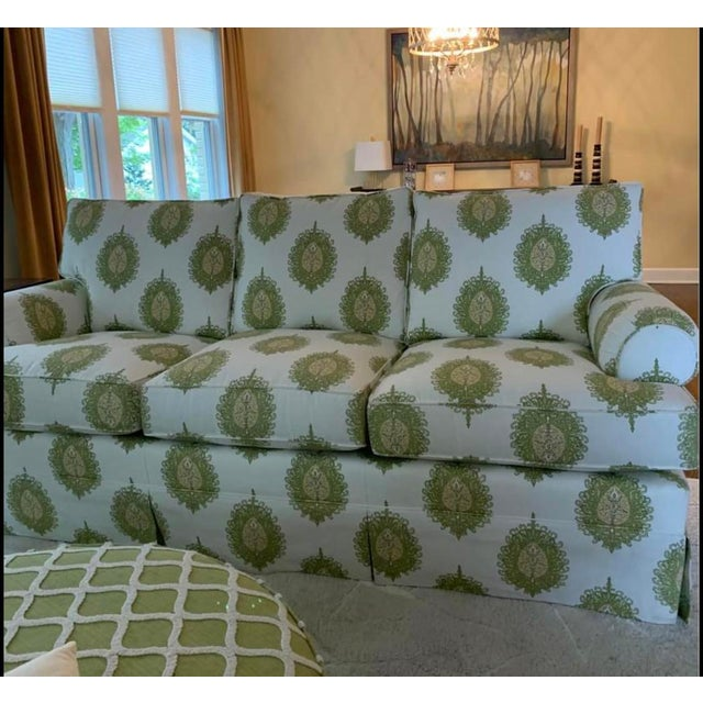 Offered is a modern three cushion sofa by Century Furniture. This sofa features a large ikat print with green and yellow...