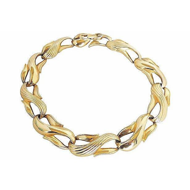 """1980s goldtone textured and smooth figure-8 link necklace with fold-over clasp. Marked """"Givenchy."""" Approximate interior..."""