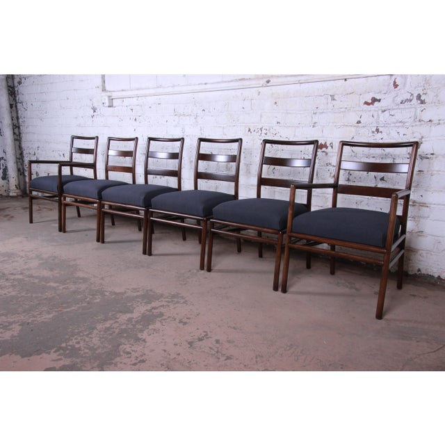 Offering an outstanding set of six mid-century modern dining chairs designed by T.H. Robsjohn-Gibbings for Widdicomb. The...