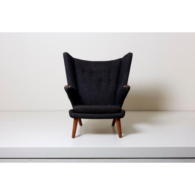 Hans J. Wegner Papa Bear chair model with Teak nails and legs. Upholstered in black fabric. Needs to be upholstered.