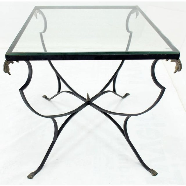 Brass duck heads claw feet nicely forged glass top wrought iron dining table.