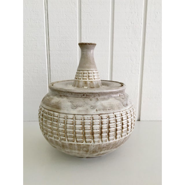 "A lidded studio pot by Douglas James Ferguson. The pot is inscribed on the bottom ""D Ferguson / 1976"". Douglas Ferguson..."
