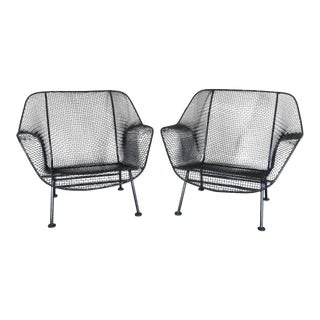 Pair of Properly Restored Black Woodard Wrought Iron With Mesh Lounge Chairs For Sale