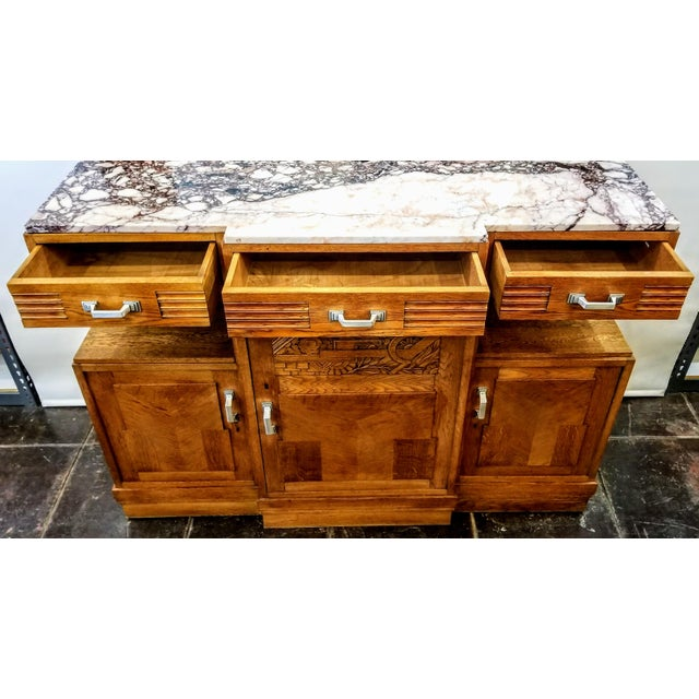 Lovely skyscraper design art deco sideboard in French oak sports a top of a very rare Greek marble from the Isle of...